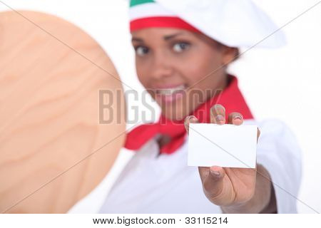 Woman pizza maker showing card