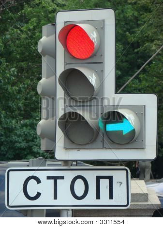 Traffic Light At Road With Red And Green Fires