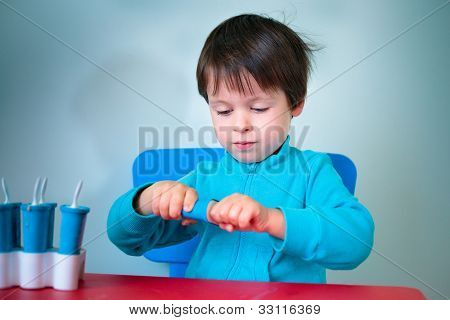 Little boy opening homemade ice cream