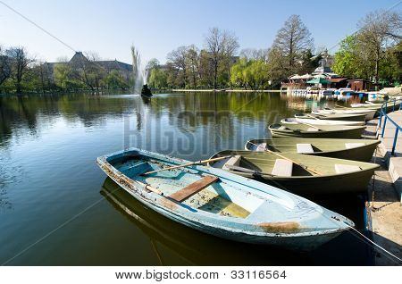 row boats for hire in lake of Cismigiu Park in Bucharest