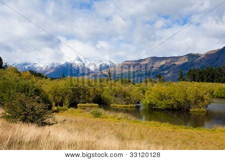Swamp, peaks and Mt Aspiring NP, Southern Alps, NZ