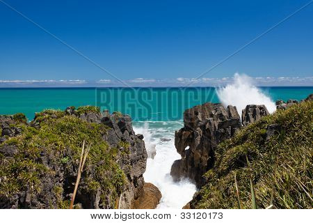 Surf in blowhole Pancake Rocks of Punakaiki, NZ