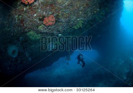 Diver Entering Swim-through Cave