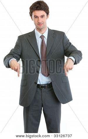 Modern Businessman Pointing Down