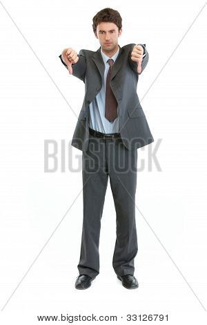 Full Length Portrait Of Businessman Showing Thumbs Down