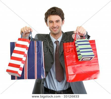 Man In Suit Stretching Hand With Shopping Bags