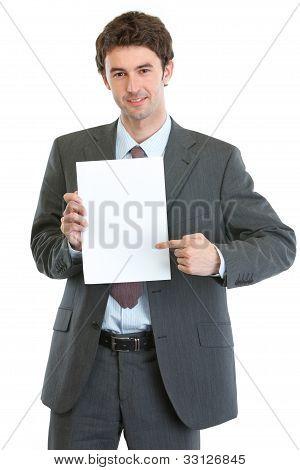 Modern Businessman Pointing On Blank Paper Sheet