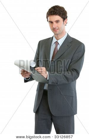 Modern Businessman Writing In Clipboard