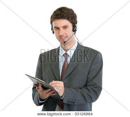 Modern Business Operator With Headset Writing In Clipboard