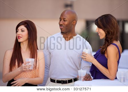 Multi Racial Group Of Friends Socializing