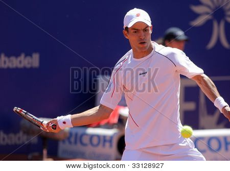 BARCELONA - APRIL, 26: Colombian tennis player Santiago Giraldo in action during his match against Rafael Nadal of Barcelona tennis tournament Conde de Godo on April 26, 2012 in Barcelona