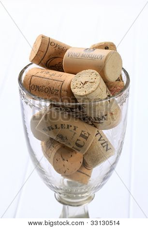New cork plugs with inscriptions in a wine glass detail