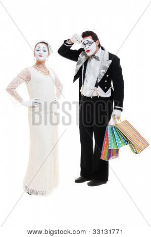 shopaholic mimes. studio shot over white background