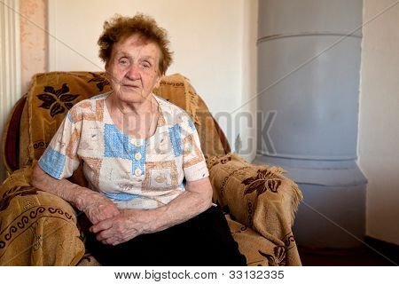 Portrait of an old woman 85 years old, in the farmhouse.