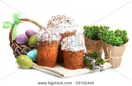 Beautiful Easter cakes, colorful eggs in basket and pussy-willow twigs isolated on white