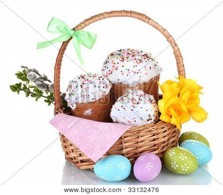 Beautiful Easter cakes in basket, colorful eggs and flowers isolated on white