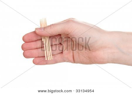 Toothpicks in hand isolated on white