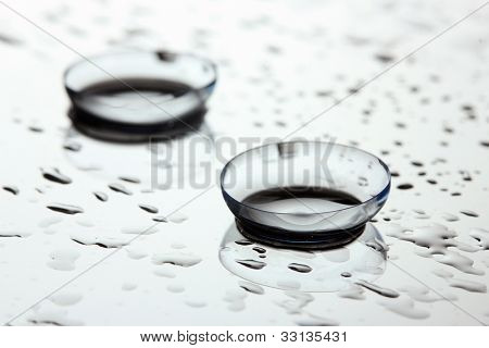 contact lens with drops on white background