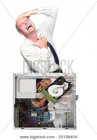Angry businessman with his destroyed computer.