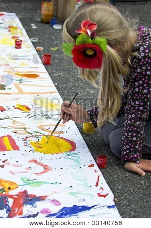 Girl Paints Pictures On A Poster