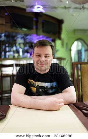 Man Posing In Cafe