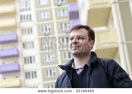 Smiling Man In Residential Area