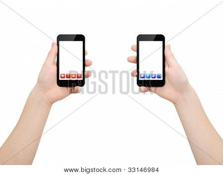 Two hands holding two smartphones