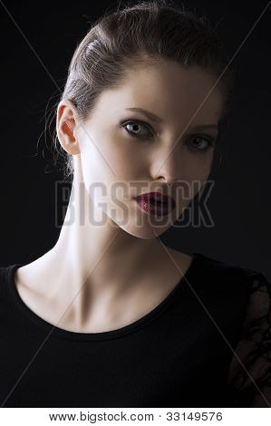 Fashion Low Key Portrait, She Is Turned Of Three Quarters