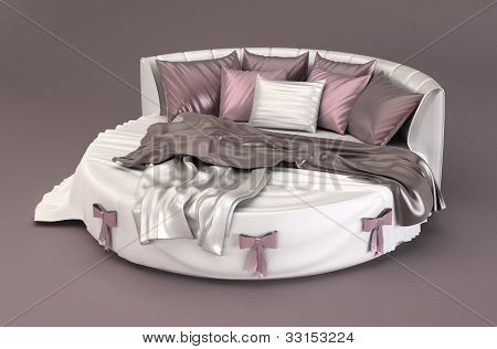 Round Bed With Pillows In Bedroom Interior