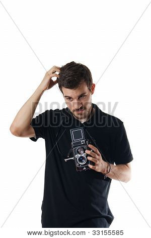Handsome Man With Vintage Photo Camera Scratching Head