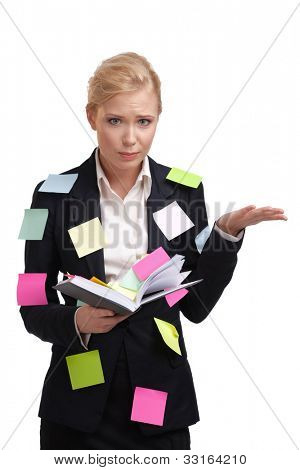 Business woman holding diary with a sticky notes on her suite