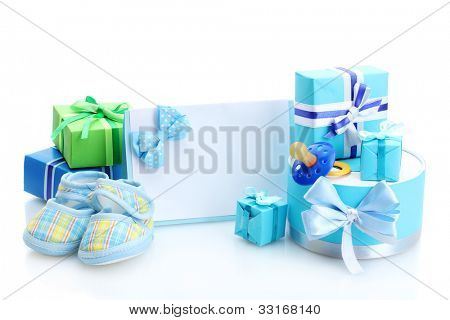 beautiful gifts, baby's bootees, blank postcard and dummy isolated on white