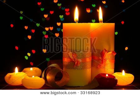 Beautiful candle and decor on wooden table on bright background
