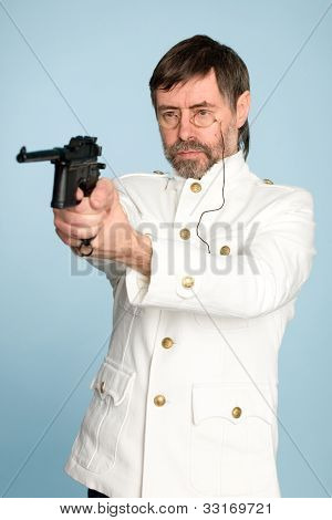 Naval officer, a pince-nez shooting with a pistol.