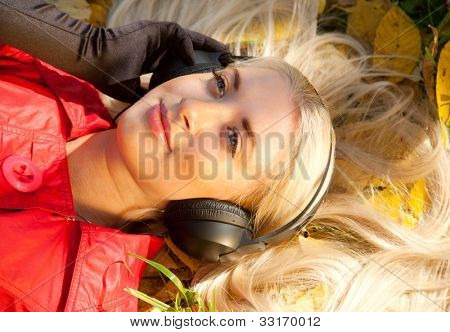 beauty girl listening music in the park