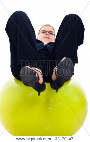 Businesswoman Balancing On Exercise Ball