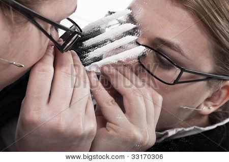 Drug Addicted Businesswoman Snorting Cocaine