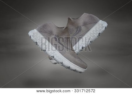 poster of Shoes Isolated On Bright Purple Background. A Pair Of Shoes Design Like Floating In The Air. Running