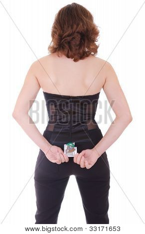 Rear View Of Young Woman In Black Holding A Condom, Isolated On White
