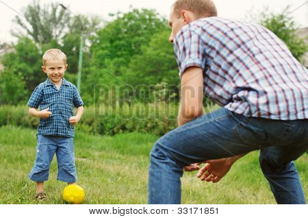 Son And Father Play In Football