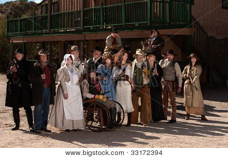 People Outside A Building In Old West Costumes