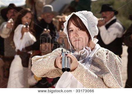 Armed Girl In Bonnet