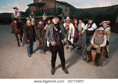 Old West Sheriff And Group Of People