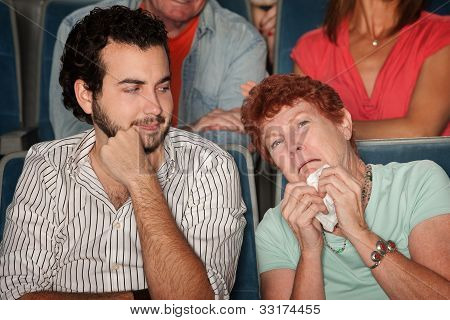 Woman Weeps In Theater