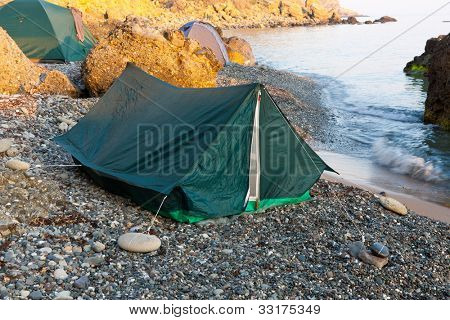tourist tents in camp near sea