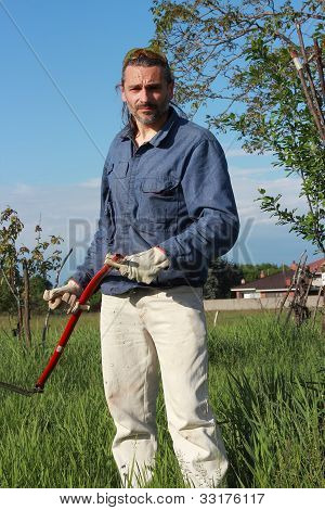 Sweating Man With Scythe