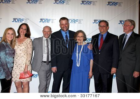 LOS ANGELES - MAY 19:  Melissa Etheridge, Linda Wallem, Stephen's Partner, Stephen Willem, Parents, brother arrives at the JDRF's  Gala at Century Plaza Hotel on May 19, 2012 in Century City, CA