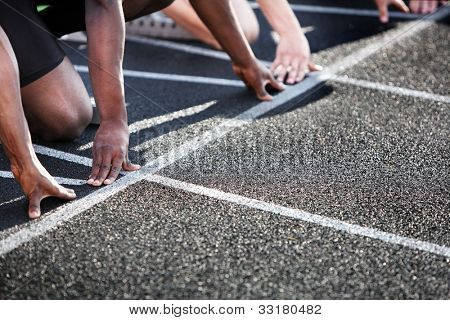 Hands on the starting line of a race