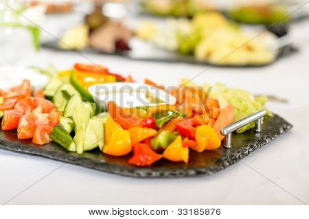 Catering table buffet full of tasty food vegetable salad plate
