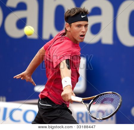 BARCELONA - MAY, 25: Serbian tennis player Filip Krajinovic in action during his match against David Ferrer of Barcelona tennis tournament Conde de Godo on April 25, 2012 in Barcelona